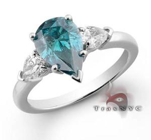 Gambar cincin emas putih 18K yang bagian tengahnya dihiasi emas biru